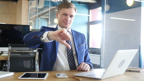Businessman showing thumbs down Footage