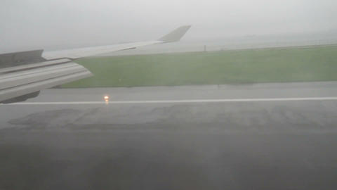 Aircraft Landing In Rain Aircraft Landing In Rain stock footage