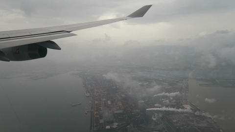 Aircraft flying over the city in the rain Footage