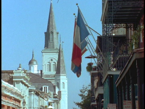 A Church And French Flags Rise Above The French Quarter stock footage