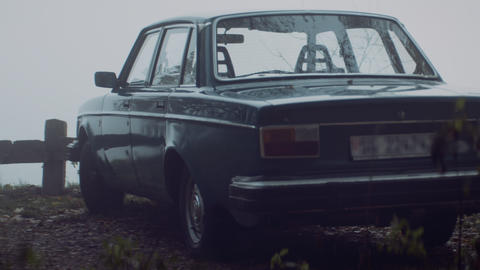 Old car riding in rural landscape with mist Footage