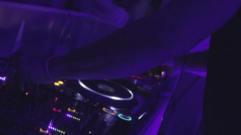 Afro DJ changes vinyl record to the rhythm of music in nightclub Footage