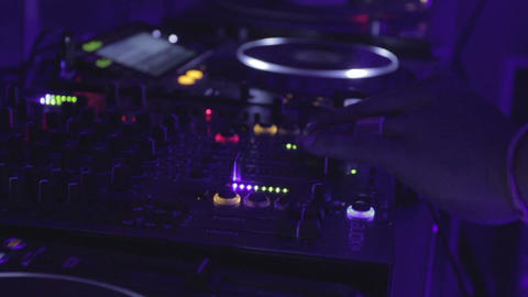 Afro Dj Playing Tweaking Equipment (mixer, Turntable, Tractor) In Nightclub stock footage