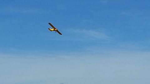 Yellow Vintage Airplane Flight, Sunny Day Blue Sky Bright Colors stock footage