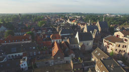 Aerial of town in Limburg early morning with birds flying,Gennep,Netherlands Footage
