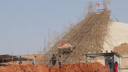 Worker in lift down stupa in contruction,Kathmandu,Boudhanath,Nepal Footage