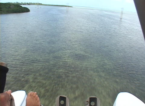 A pilot in an ultralight airplane lands in the ocean Footage