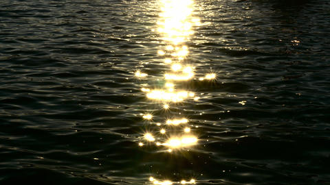 Sunlight reflections on dark and murky water Footage