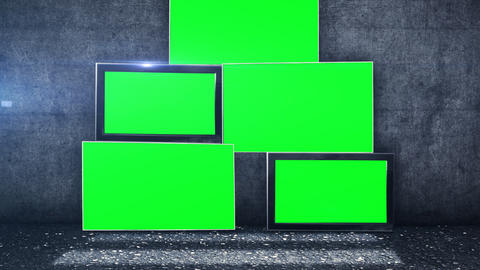 Tv Screens In Green Screen Picture In Front Of A Grunge Wall stock footage