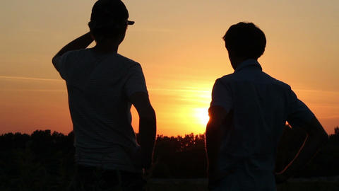Friendship, teamwork, two male best friends enjoying dusk Footage