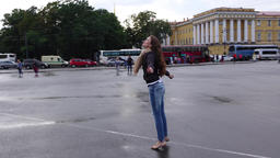 Tourist girl happily spin turn around on Palace Square against Alexander Column Footage