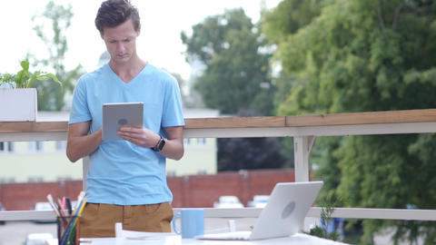 Sunny Day, Man Standing and Browsing on Tablet in Balcony, Gadget Footage