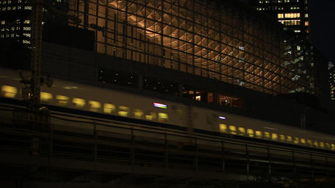 Shinkansen bullet train that passes through the previous international forums./ Footage