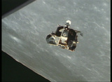 Aerial shot of the Apollo lunar module circling the moon Footage
