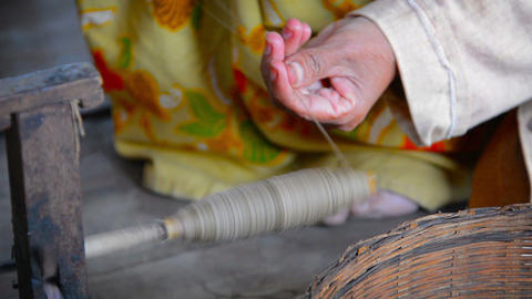 Burmese Woman Winding Thread onto a Spool to Make Yarn Footage