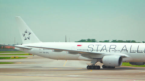 Star Alliance Airliner taxiing to runway for takeoff. Changi Airport. Singapore Footage