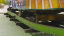 Close up of a vintage kiddie train carnival ride on metal tracks in slow motion  Footage