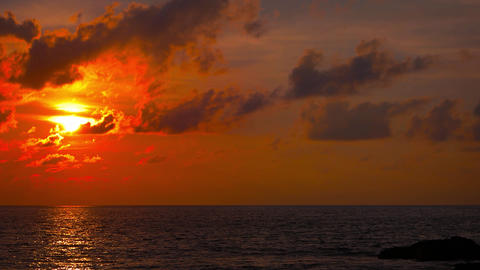 Sunset Colors over the Horizon of a Flat Tropical Sea Footage