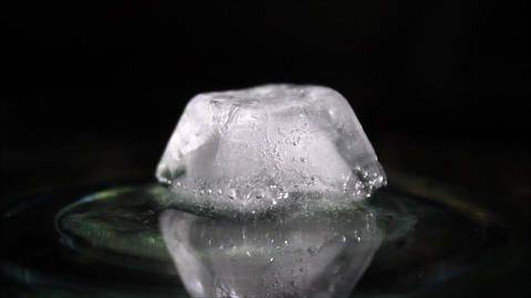 Melting ice cube air bubbles inside Footage