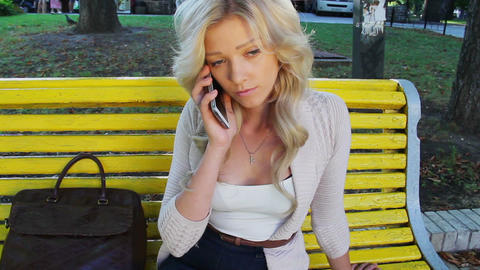 Beautiful woman calling on phone in park no answer girl hangs up Footage