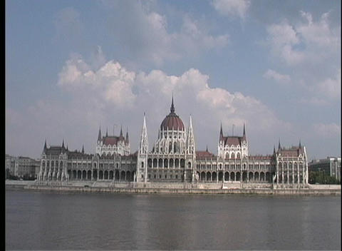 A long-shot, across water, of the Parliament Building in Budapest, Hungary Footage