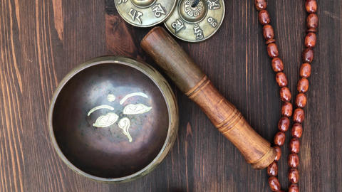 Items for religious ritual singing bowl, a drum beads, magic balls Footage