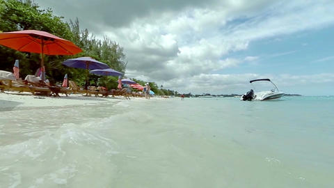 View of a beach and crystal clear waters on a sunny day, Mauritius , Indian ocea Footage