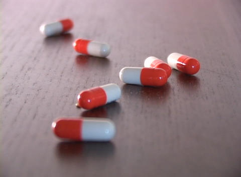 Focus On Seven Red And White Pill Capsules Changes From The Back Of Shot, To The Front stock footage