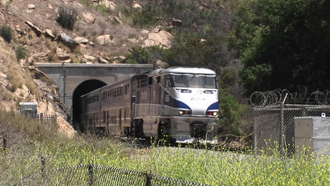 A Amtrak passenger train passes through a hillside tunnel near Los Angeles Footage
