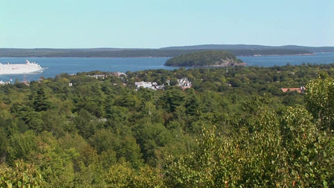 A White Cruise Ship Is Seen In The Distance Of A Forest In Bar Harbor, Maine stock footage