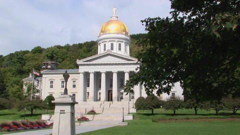 A gold dome tops the capital building in Montpelier, Vermont Footage