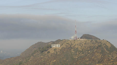 Time lapse motion of clouds blowing over the Hollywood sign and Cahuenga Peak above Hollywood, Calif Footage