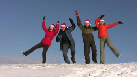 Dancing Friends With Christmas Hats On Snow stock footage