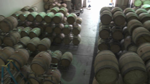 Pan Across Barrels Of Beer In A Warehouse stock footage
