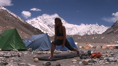 Attractive Woman Does Yoga At Mt. Everest Base Camp - Everest North Face In The Background stock footage