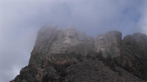 A misty view of Mt. Rushmore's world-renowned sculptures Footage