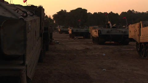 A Line Of Israeli Army Vehicles Are Parked Along The Israel - Gaza Strip Border stock footage