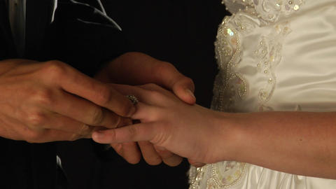 The Groom Slips A Ring On The Bride's Finger stock footage