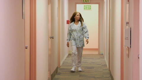 A medical professional walks down the hallway of a medical facility Footage