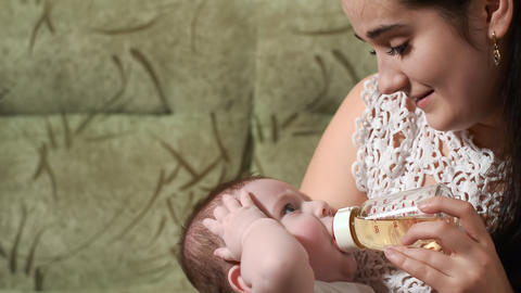 Mother Feeds Baby Boy Bottle stock footage