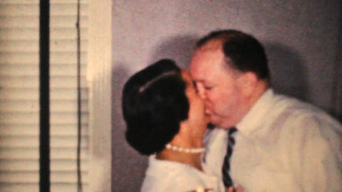 Couple Kissing At New Years Party 1964 Vintage 8mm Film stock footage