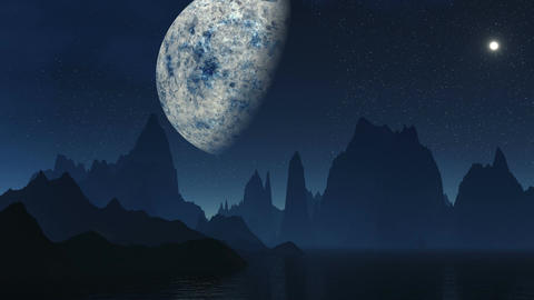 The Fantastic Moon Against Mountains stock footage