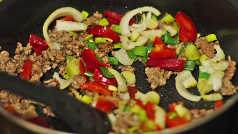 Preparing Dinner. Frying Meat With Vegetables stock footage