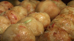 Takoyaki ('octopus Balls') Being Prepared In A Jap stock footage