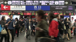 Passengers Exit Gates Of A Busy Kyoto Train Statio stock footage