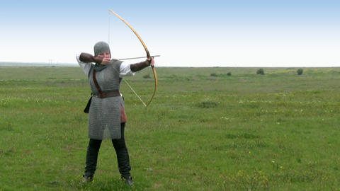 Medieval warrior - girl shoots a bow Footage