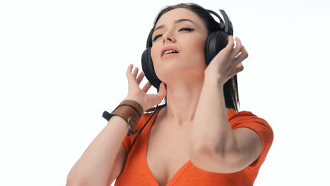 Young Beautiful Sexy Girl Listening To Music On Headphones stock footage