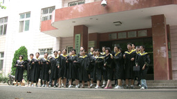 Chinese Students Graduate And Throw Hats In The Ai stock footage