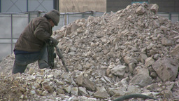 A Chinese Worker Is Drilling Concrete stock footage