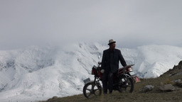 Kyrgyz Man Greets Friends At Motorbike Before Moun stock footage